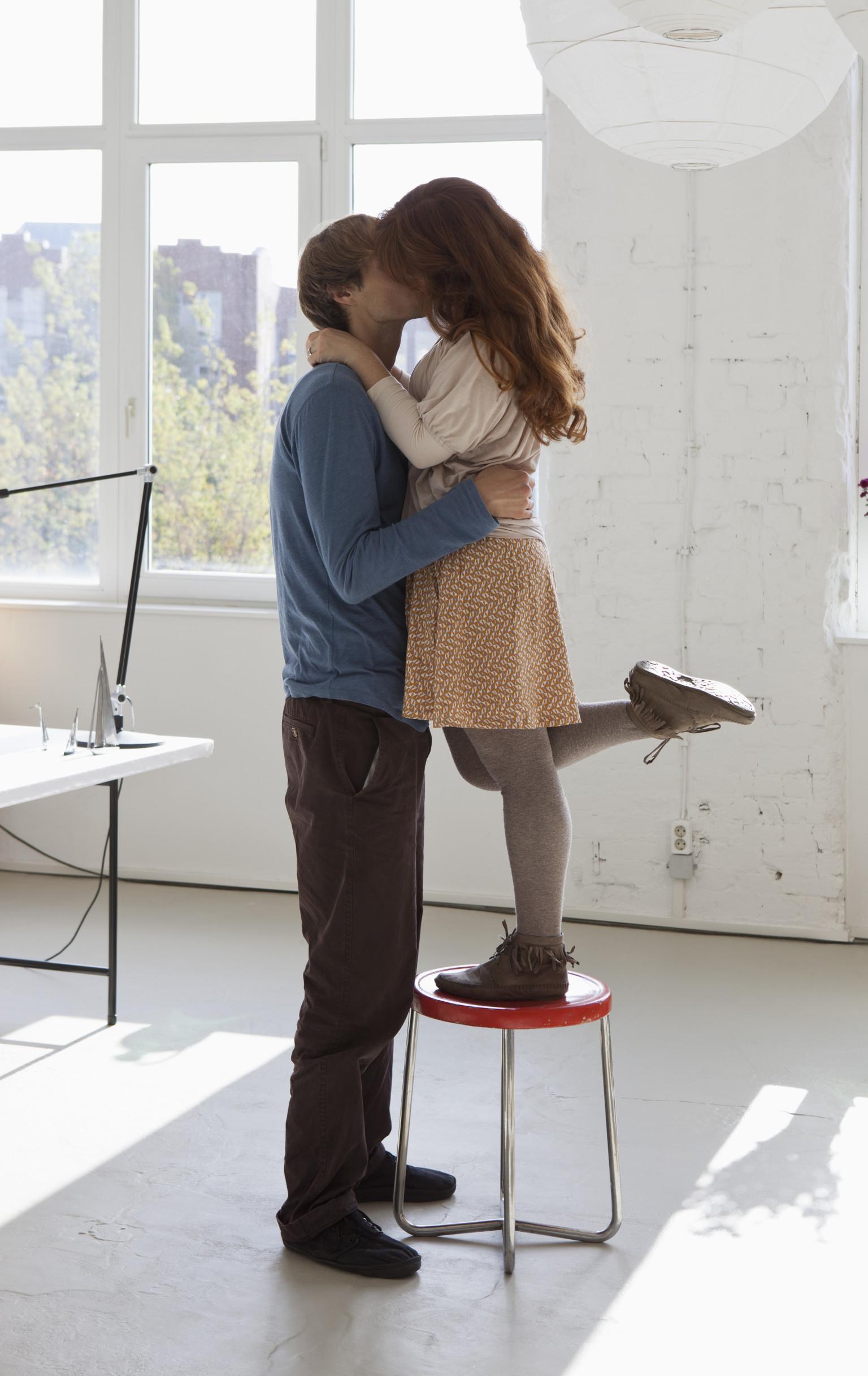 tall boy kissing short girl