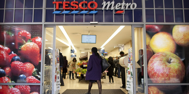 A customer walks into a Tesco Metro supermarket