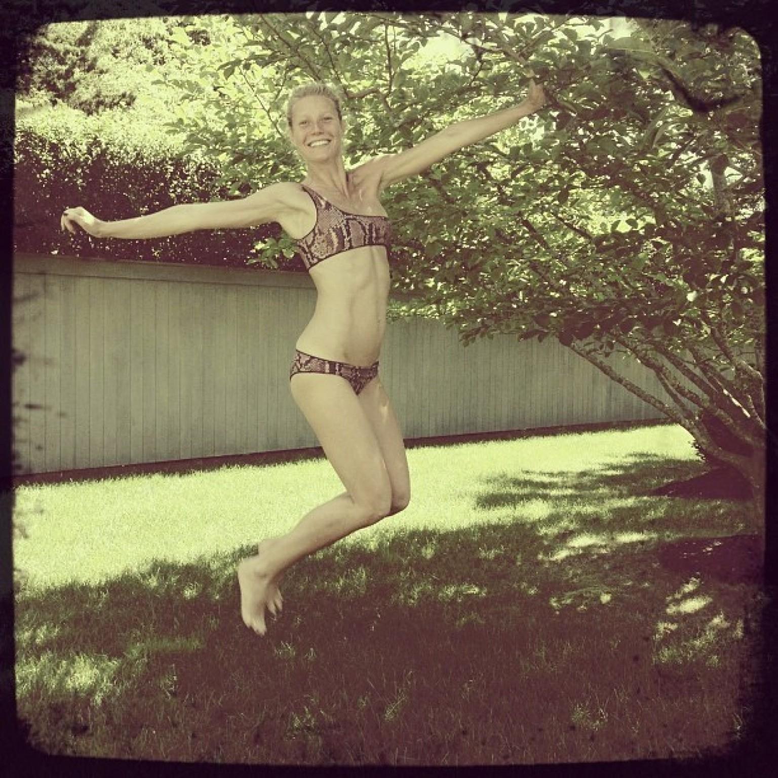 Teen planet jumping in bikinis