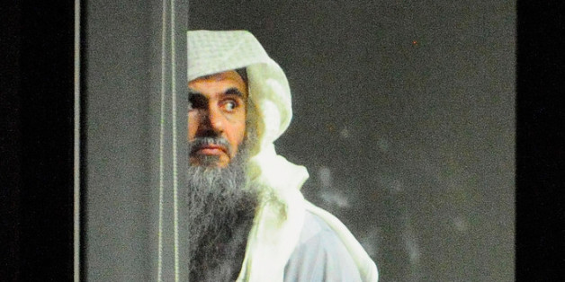 Radical cleric Abu Qatada (L) prepares to board a plane at RAF Northolt which will take him to Jordan, after he was deported from the UK to face terrorism charges in his home country, on July 7, 2013 in London, England. (Photo by Sgt Ralph Merry/MoD via Getty Images)