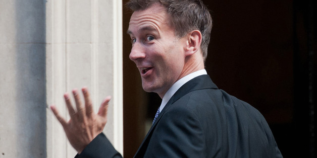British politician Jeremy Hunt gestures towards the media as he arrives at no 10 Downing Street in central London on September 4, 2012 to meet with Britain's Prime Minister David Cameron and receive his new appointment as health secretary in Cameron's first cabinet reshuffle. Cameron reshuffled his ailing coalition government on September 4, but unpopular finance minister George Osborne was expected to keep his job. Jeremy Hunt was moved from culture secretary to be the new health secretary with