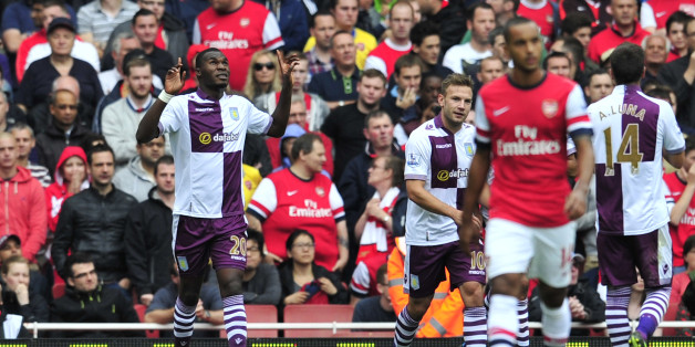 Aston Villa's Belgian striker Christian Benteke (L) celebrates scoring his team's first goal to equalise the score line during the English Premier League football match between Arsenal and Aston Villa at the Emirates stadium in North London on August 17, 2013. AFP PHOTO/GLYN KIRK   == RESTRICTED TO EDITORIAL USE. NO USE WITH UNAUTHORIZED AUDIO, VIDEO, DATA, FIXTURE LISTS, CLUB/LEAGUE LOGOS OR LIVE SERVICES. ONLINE IN-MATCH USE LIMITED TO 45 IMAGES, NO VIDEO EMULATION. NO USE IN BETTING, GAMES OR