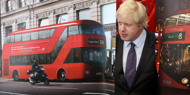 LONDON, ENGLAND - MAY 17:  Mayor of London Boris Johnson poses with artists impressions of the design for London's new Routemaster bus on May 17, 2010 in London, England. The new double-decker buses, which will feature a rear open platform enabling people to 'hop-on hop-off', are claimed to be 40% more fuel efficient than current London buses and are due to go into service in 2011.  (Photo by Oli Scarff/Getty Images)