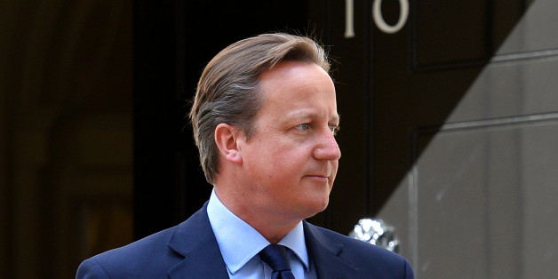 British Prime Minister, David Cameron awaits the arrival of the King of Bahrain, Sheikh Hamad bin Issa Al-Khalifah to Downing street in central London on August 6, 2013.  AFP PHOTO / BEN STANSALL        (Photo credit should read BEN STANSALL/AFP/Getty Images)
