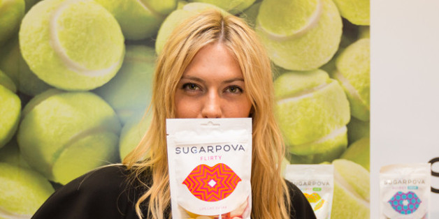 PARIS, FRANCE - MAY 22: Tennis player Maria Sharapova poses with a Sugarpova candy packet during the French launch of her Sugarpova candy collection at Colette on May 22, 2013 in Paris, France.  (Photo by Richard Bord/Getty Images for Sugarpova)