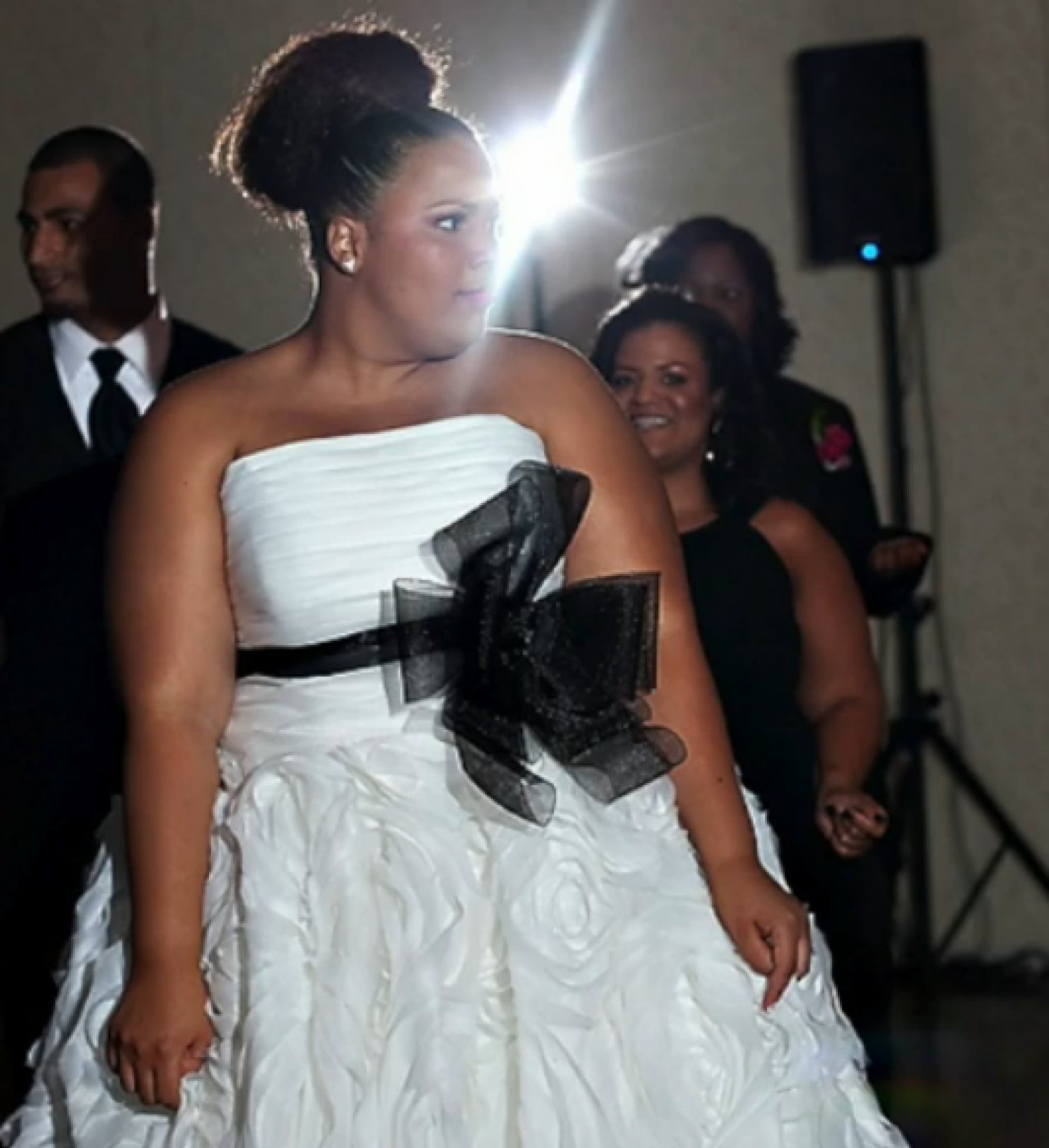 Plus-Size Bride Wrapped In Elastic Band During Wedding