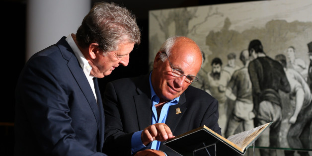 Greg Dyke and Roy Hodgson examine the £2.5m book