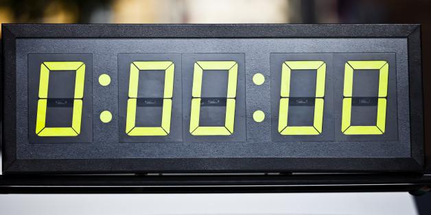 Digital timing clock at start line of marathon race.