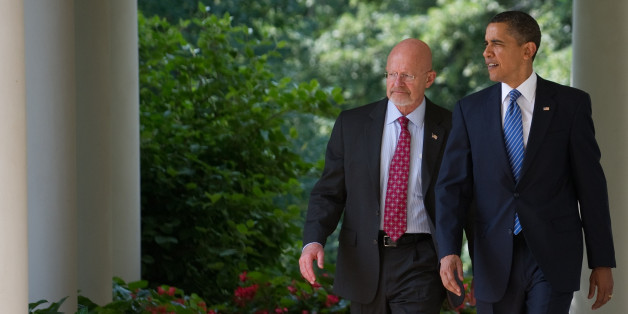 US President Barack Obama walks back down the West Wing Colonnade alongside retired General James Clapper, Obama's nominee for director of national intelligence, before making a statement in the Rose Garden of the White House in Washington, DC, June 5, 2010. AFP PHOTO / Saul LOEB (Photo credit should read SAUL LOEB/AFP/Getty Images)