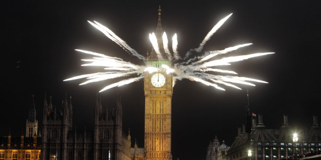 Fireworks explode from the top of St Stephen's Tower at the House of Parliament in London to celebrate the start of the new year.