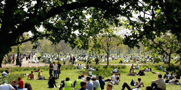 LONDON - APRIL 17:  People enjoy the sun and high temperature at Green Park April 17, 2003 in London. Temperatures on April 16 matched those of Cyprus and beat those of Greece, Italy and coastal Spain, where many Britons are heading over the Easter break. Despite the heat, 1.8 million people are expected to leave Britain, with a million passengers departing by air. (Photo by Scott Barbour/Getty Images)