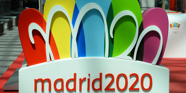The logo for the city of Madrid's candidature for the 2020 Summer Olympic Games is pictured at the entrance of an exhibition on August 29, 2013 in Madrid. Madrid is bidding against Istanbul and Tokyo to host the 2020 Olympic and Paralympic Summer Games. The International Olympic Committee (IOC) will reveal the host city at the 125th IOC Session in Buenos Aires next September 7.     AFP PHOTO / GERARD JULIEN        (Photo credit should read GERARD JULIEN/AFP/Getty Images)