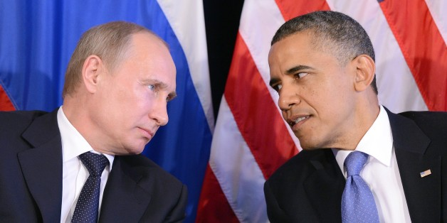 US President Barack Obama (R) listens to Russian President Vladimir Putin after their bilateral meeting in Los Cabos, Mexico on June 18, 2012 on the sidelines of the G20 summit. Obama and President Vladimir Putin met Monday, for the first time since the Russian leader's return to the presidency, for talks overshadowed by a row over Syria. The closely watched meeting opened half-an-hour late on the sidelines of the G20 summit of developed and developing nations, as the US leader sought to preserv