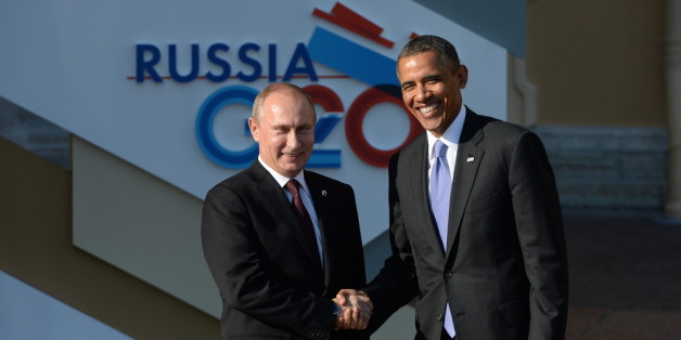ST. PETERSBURG, RUSSIA - SEPTEMBER 05:  In this handout image provided by Host Photo Agency, Russian President Vladimir Putin (L) greets U.S. President Barack Obama at the G20 summit on September 5, 2013 in St. Petersburg, Russia. The G20 summit is expected to be dominated by the issue of military action in Syria while issues surrounding the global economy, including tax avoidance by multinationals, will also be discussed during the two-day summit.  (Photo by Ramil Sitdikov/Host Photo Agency via