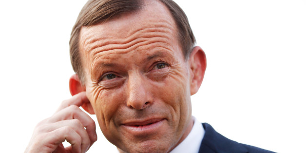 Tony Abbott, Australia's opposition leader, adjusts his earpiece before a television interview outside the polling station at the Freshwater Surf Life Saving Club in Sydney, Australia, on Saturday, Sept. 7, 2013. Australian voters are heading to eject the Labor party after six years in power, with opinion polls showing they will put Abbott's Liberal-National coalition in charge of the $1.5 trillion economy. Photographer: Brendon Thorne/Bloomberg via Getty Images