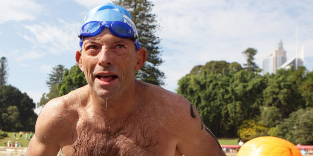 SYDNEY, AUSTRALIA - JANUARY 26:  Opposition leader Tony Abbott completes the Body Science Great Australian Swim Series at the Sydney Harbour on January 26, 2011 in Sydney, Australia. The inaugural ocean swim event brings people of all ages together to compete in distances between 300 metres and 2.5 kilometres against the backdrop of the Sydney Harbour.  (Photo by Craig Golding/Getty Images)