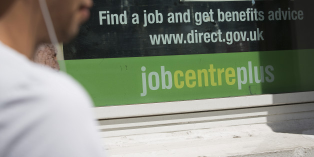 A pedestrian walks past a job centre in London, U.K., on Tuesday, Aug. 6, 2013. Bank of England governor Mark Carney will present a review tomorrow on implementing forward guidance in the U.K. as improving economic data boosts the future cost of money. Photographer: Simon Dawson/Bloomberg via Getty Images