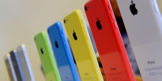 The new Apple Inc. iPhone 5C sit on display during a product announcement in Cupertino, California, U.S., on Tuesday, Sept. 10, 2013. Apple Inc. announced two new iPhones including one with lower prices and more color options, in a strategy shift by Cook to reach a broader range of customers around the world. Photographer: David Paul Morris/Bloomberg via Getty Images