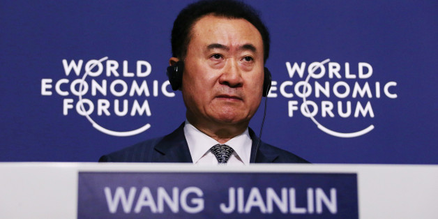 Billionaire Wang Jianlin, chairman and president of Dalian Wanda Group, listens during a news conference at the World Economic Forum Annual Meeting Of The New Champions in Dalian, China, on Wednesday, Sept. 11, 2013. Wang, China's richest man and owner of the country's biggest commercial land developer, said he has hired two investment banks to buy hotel management companies, mostly in the U.S. Photographer: Tomohiro Ohsumi/Bloomberg via Getty Images