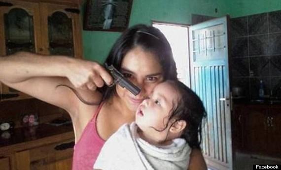 woman pointing gun