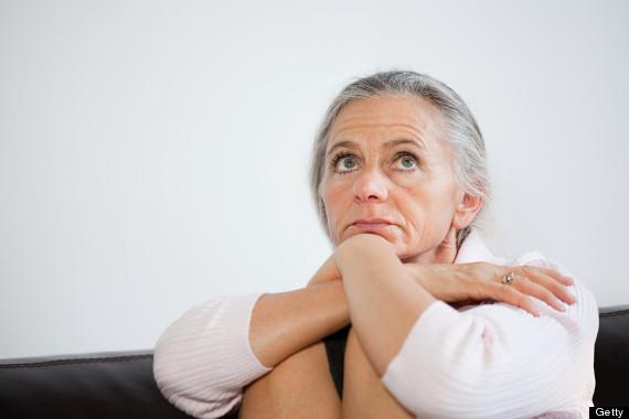 older woman looking pensive