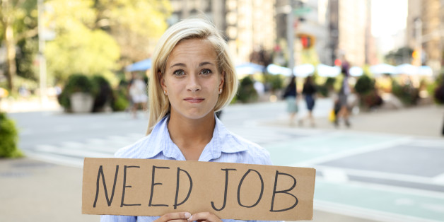A woman holding a sign saying 'need job'