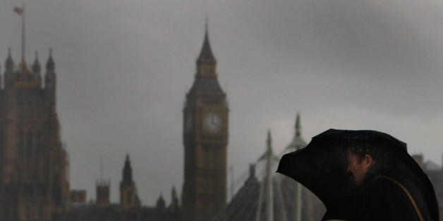 LONDON - MARCH 10:  A man holds onto his umbrella as he braves wind and rain on Waterloo Bridge on March 10, 2008 in London, England. Commuters battled rain and winds of up to 60 miles per hour on their way to work.  (Photo by Daniel Berehulak/Getty Images)