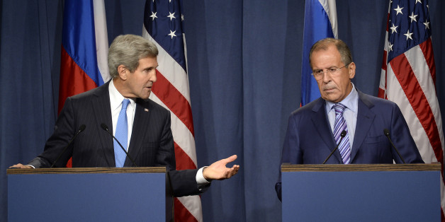 US Secretary of State John Kerry (L) and Russian Foreign minister Sergey Lavrov (R) give a press conference in Geneva following their meeting on Syria's chemical weapons, on September 12, 2013.  Russian Foreign Minister Sergei Lavrov on September 12 said there was still 'a chance for peace' in Syria as he prepared for high-stakes talks with his US counterpart on a plan for Damascus to give up its chemical weapons. Before leaving for the talks in Geneva, Lavrov said during a visit to Kazakhstan t