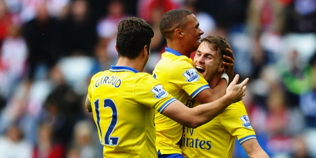 SUNDERLAND, ENGLAND - SEPTEMBER 14: Aaron Ramsey (R) of Arsenal celebrates his goal with team mates Kieran Gibbs and Olivier Giroud during the Barclays Premier League match between Sunderland and Arsenal at the Stadium of Light on September 14, 2013 in Sunderland, England.  (Photo by Laurence Griffiths/Getty Images)