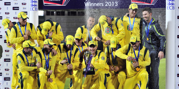 The Australian team celebrate with the trophy after winning the fifth One Day International (ODI) cricket match between England and Australia at the Ageas Bowl in Southampton, England on September 16, 2013.  Shane Watson's century saw Australia to a 49-run win over England in the fifth one-day international at Southampton as their lengthy tour ended with a 2-1 series victory. AFP PHOTO / GLYN KIRK    RESTRICTED TO EDITORIAL USE. NO ASSOCIATION WITH DIRECT COMPETITOR OF SPONSOR, PARTNER, OR SUPPL
