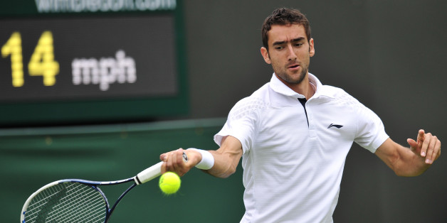 Croatia's Marin Cilic returns against Cyprus's Marcos Baghdatis on his way to victory in their men's first round match on day one of the 2013 Wimbledon Championships tennis tournament at the All England Club in Wimbledon, southwest London, on June 24, 2013. Cilic won 6-3, 6-4, 6-4.  AFP PHOTO / GLYN KIRK -  RESTRICTED TO EDITORIAL USE        (Photo credit should read GLYN KIRK/AFP/Getty Images)
