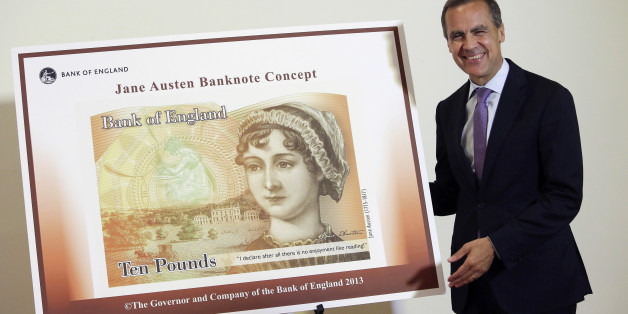 Mark Carney, governor of the Bank of England, stands alongside the concept design for the new Bank of England ten pound banknote, featuring author Jane Austen during the presentation at the Jane Austen House Museum in Chawton, near Alton, U.K., on Wednesday, July 24, 2013. Jane Austen will appear on the U.K.'s next 10-pound note, ensuring at least one female figure is represented on the currency in circulation. Photographer: Chris Ratcliffe/Bloomberg via Getty Images