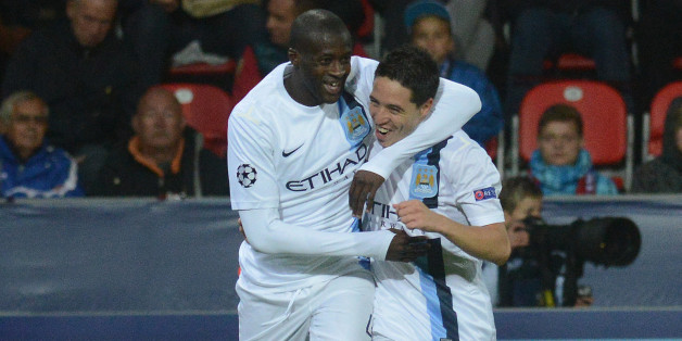 Manchester City's Ivorian midfielder Yaya Toure (L) celebrates with his teammate French midfielder Samir Nasri after he scored during the UEFA Champions League Group D football match FC Viktoria Plzen vs Manchester City in Plzen on September 17, 2013.    AFP PHOTO / MICHAL CIZEK        (Photo credit should read MICHAL CIZEK/AFP/Getty Images)