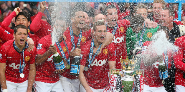 MANCHESTER, ENGLAND - MAY 12:  The Manchester United players celebrate with the Premier League trophy following the Barclays Premier League match between Manchester United and Swansea City at Old Trafford on May 12, 2013 in Manchester, England.  (Photo by Alex Livesey/Getty Images)
