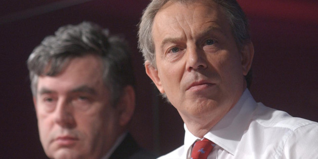 UNITED KINGDOM - APRIL 28:  British Prime Minister Tony Blair, right, and U.K. Chancellor Gordon Brown listen at a press conference in London, Thursday, April 28, 2005. Blair pledged to open discussions with leaders of Britain's financial services industry on reducing regulation after the May 5 election, while declining to rule out increases in corporation taxes.  (Photo by Andy Shaw/Bloomberg via Getty Images)