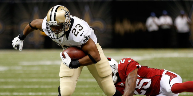 New Orleans Saints' Pierre Thomas avoids a tackle by Rashad Johnson