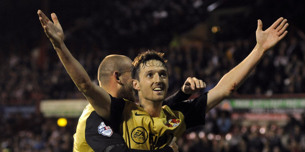 David Mooney celebrates his opener at Griffin Park