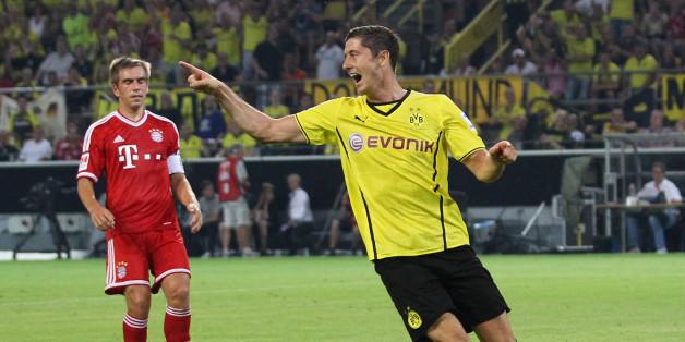 DORTMUND, GERMANY - JULY 27:  Robert Lewandowski (R) of Dortmund celebrates during the DFL Supercup match between Borussia Dortmund and FC Bayern Muenchen at Signal Iduna Park on July 27, 2013 in Dortmund, Germany.  (Photo by Boris Streubel/Getty Images)