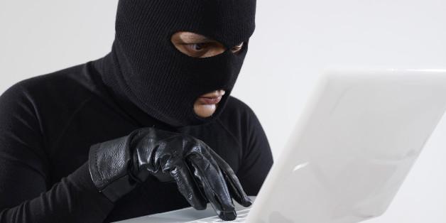 Hacker stealing data.