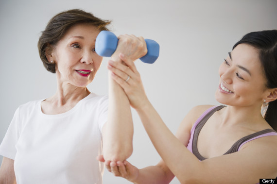older person lifting weights