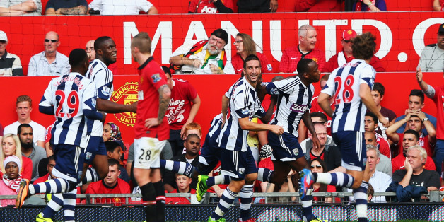 MANCHESTER, ENGLAND - SEPTEMBER 28:  Saido Berahino (2nd right) of West Bromwich Albion celebrates with team mates after scoring his sides second goal during the Barclays Premier League match between Manchester United and West Bromwich Albion at Old Trafford on September 28, 2013 in Manchester, England.  (Photo by Alex Livesey/Getty Images)