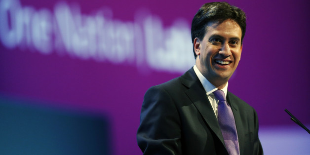 Britain's opposition Labour Party leader Ed Miliband gestures during a Question and answer session during the conclusion of the final day of the Labour party conference in Brighton, Sussex, south England on September 25, 2013.  Britain's opposition Labour leader Ed Miliband positioned himself as the champion of hard-pressed working families, using a speech to his party's annual conference to promise a freeze on energy prices and higher wages.  AFP PHOTO / ADRIAN DENNIS        (Photo credit shoul