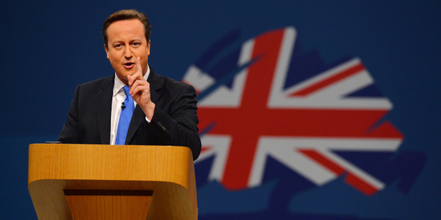 British Prime Minister David Cameron addresses delegates at the annual Conservative Party Conference in Manchester, north-west England, on October 2, 2013.     AFP PHOTO / PAUL ELLIS        (Photo credit should read PAUL ELLIS/AFP/Getty Images)