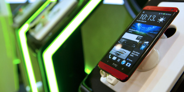 An HTC Corp. One mobile phone is displayed at the IFA consumer electronics show in Berlin, Germany, on Friday, Sept. 6, 2013. Global smartphone revenue will rise 22 percent in 2013, or nearly half the pace of an expected 41 percent gain in shipments, amid falling prices, according to UBS. Photographer: Krisztian Bocsi/Bloomberg via Getty Images