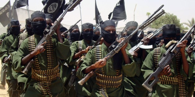 Al-Shabab fighters march with their guns during military exercises on the outskirts of Mogadishu,Somalia