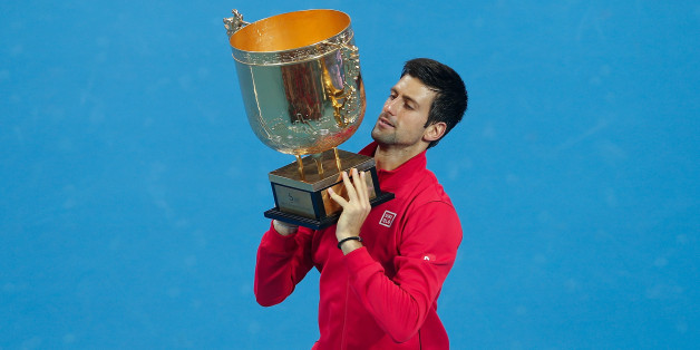 BEIJING, CHINA - OCTOBER 06: Novak Djokovic of Serbia poses with his trophy during the medal ceremony after winning the Men's Single Final of the China Open at the China National Tennis Center on October 6, 2013 in Beijing, China. (Photo by Lintao Zhang/Getty Images)