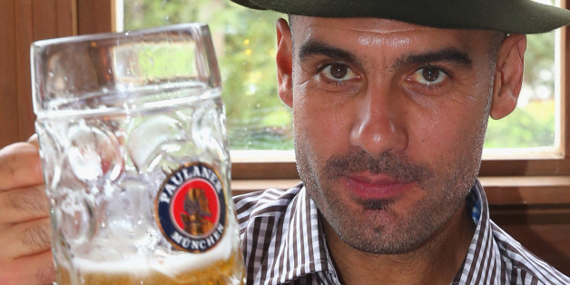 MUNICH, GERMANY - OCTOBER 06:  Pep Guardiola, head coach of Bayern Muenchen attends with his wife Christina Guardiola the Oktoberfest 2013 beer festival at Kaefers Wiesenschaenke on October 6, 2013 in Munich, Germany.  (Photo by Alexander Hassenstein/Bongarts/Getty Images)