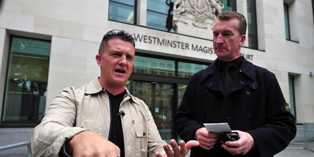 (FILES) In this file picture taken on September 11, 2013 Stephen Yaxley-Lennon (L), also known as Tommy Robinson, the co-founder, spokesman and leader of the English Defence League (EDL) and EDL Deputy Leader Kevin Carroll (R) leave after attending Westminster Magistrates Court in central London.   The leader of Britain's far-right, anti-Islamic English Defence League quit on October 8, 2013, saying he felt he could no longer keep 'extremist elements' in the group at bay. In a surprise move, EDL