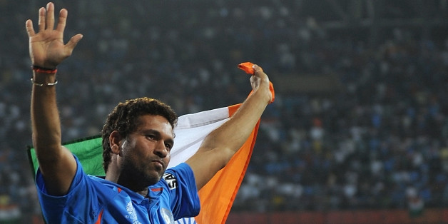 Indian cricketer Sachin Tendulkar waves the tricolor while celebrating victory during the final of ICC Cricket world Cup 2011 match between India and Sri Lanka at The Wankhede Stadium in Mumbai on April 2, 2011.India beat Sri Lanka by six wickets.  AFP PHOTO/Prakash SINGH (Photo credit should read PRAKASH SINGH/AFP/Getty Images)