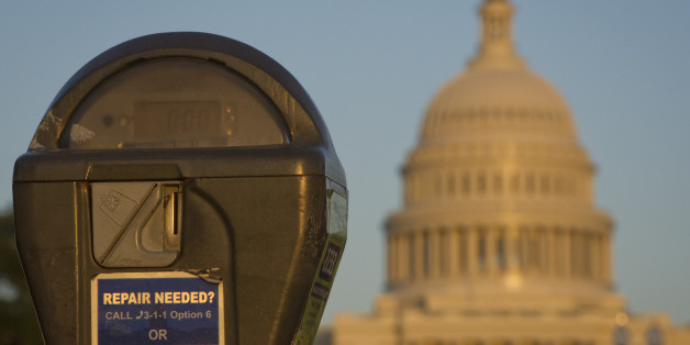 The US Congress building is seen behind a parking meter in Washington, DC, October 14, 2013.  The crisis over a US government shutdown and debt ceiling standoff continues into the third week of the shutdown. With just three days before the US Treasury exhausts its borrowing authority, and the government entering its third week of a crippling shutdown, lawmakers have scrambled to work out a deal that would resolve both crises.  AFP PHOTO/ MLADEN ANTONOV        (Photo credit should read MLADEN ANT